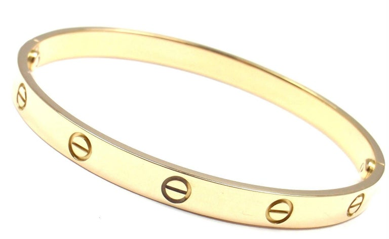 18k Yellow Gold Love Bangle Bracelet by Cartier Size 20. This bracelet comes with a Cartier box, service paper from Cartier store in Japan and a Cartier screwdriver.  Details:  Size: 20 Weight: 36.9 grams Width: 6.5mm  Hallmarks: Cartier 750 20