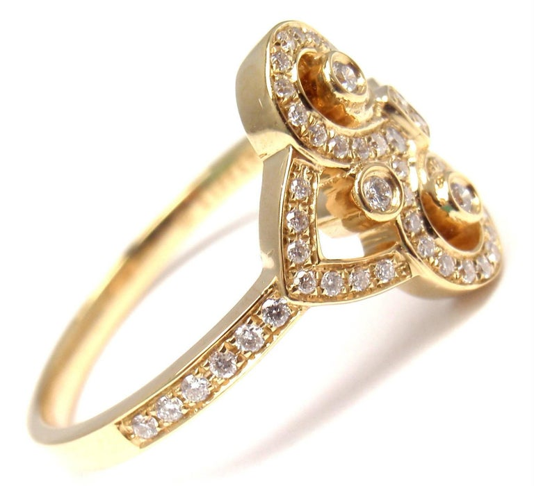 18k Yellow Gold Diamond Fleur de Lis Key Band Ring by Tiffany & Co. With Round brilliant cut diamonds VS1 clarity, G color total weight approx. .21ct This ring comes with Tiffany & Co box. Measurements:  Ring Size: 7 Weight: 4.5 grams Band Width: