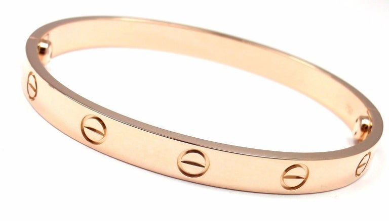 18k Rose Gold New Screw System Love Bangle Bracelet by Cartier.  Size 17.   This bracelet comes with a Cartier certificate, box and a screwdriver. Details:  Size: 17  Weight: 30.9 grams Width: 6.5mm  Hallmarks: Cartier 750 17 X02064 *Free Shipping