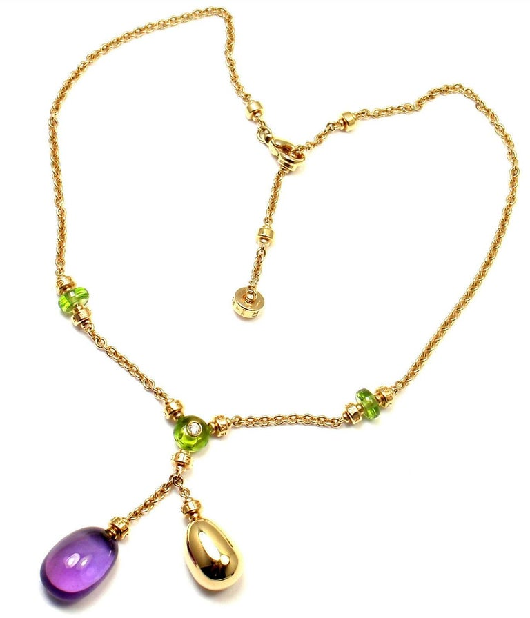 18k Yellow Gold Sassi Mediterranean Diamond Peridot Amethyst Necklace by Bulgari.   With 3 peridots 1 large amethyst 1 round brilliant cut diamond VS1 clarity, G color total weight approx. .05ct Retail Price: $13,000 plus tax. Details:   Length: