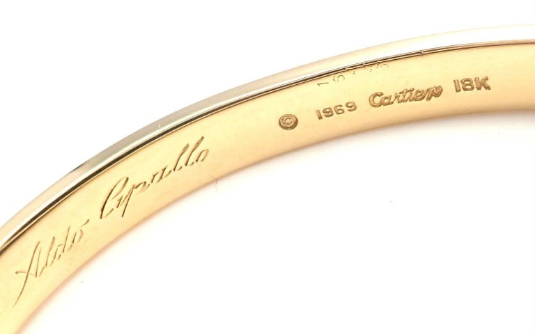 18k Yellow Gold Original Vintage Love Bangle Bracelet by Aldo Cipullo for Cartier. This bracelet comes with a Cartier box and Cartier screwdriver. Details:  Size: 16 Weight: 12 grams Width: 6.5mm  Hallmarks: Cartier 18k 1969 16443 *Free Shipping