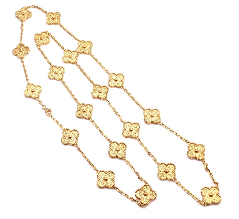 18k Yellow Gold Alhambra 20 Motif Necklace by Van Cleef & Arpels.  With 20 motifs of 18k yellow gold alhambras 15mm each. This necklace comes with VCA box and certificate. Details:  Length: 33