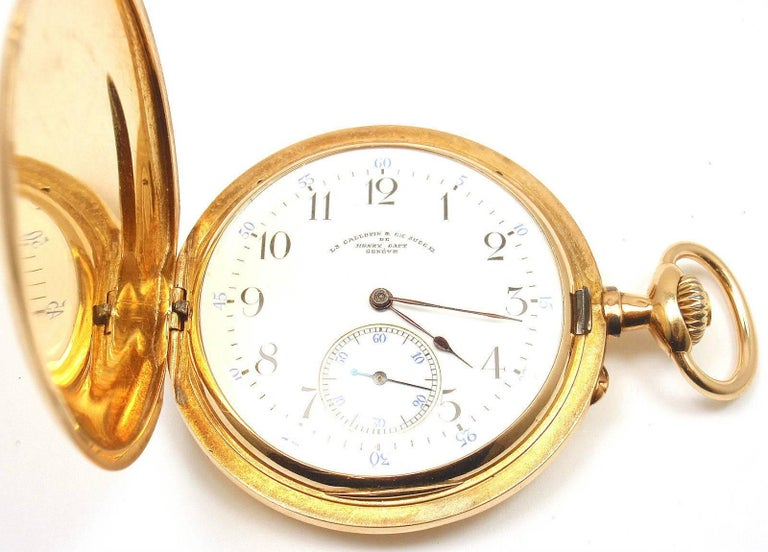 18k Yellow Gold Full Hunter Case Pocket Watch by Henry Capt.  This watch has a solid 18k yellow gold case. Works great, fully functional. Details:  Case Size: 48mm Weight: 87.2 grams Movement: Chronoautomatic Stamped Hallmarks: Henry Capt, L.