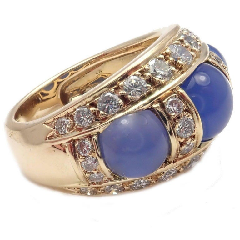 18k Yellow Gold Diamond And Chalcedony Ring by Piaget.  With 34 round brilliant cut diamonds VS1 clarity, G color total weight approximately  1ct 3 chalcedony stones. Details:  Size: 5.5 Width: 13mm Weight: 11.1 grams Stamped Hallmarks: Piaget