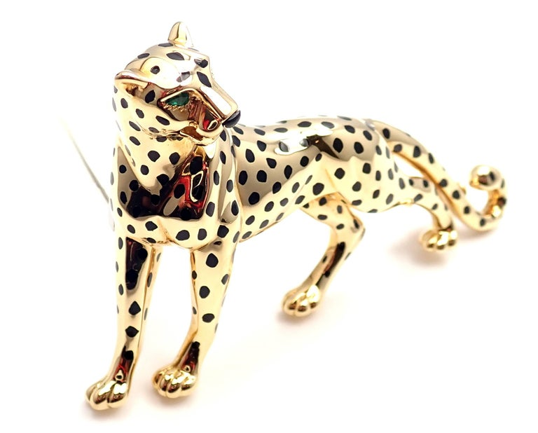 18k Yellow Gold Onyx Emerald Large Panther Pin Brooch by Cartier.  This brooch comes with an original Cartier box.  With Black Onyx Spots, Emerald eyes.  Details:   Measurements: 2 3/4