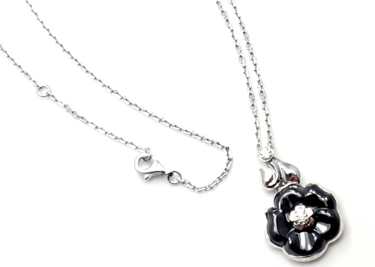 18k White Gold Diamond Black Ceramic Camelia Camellia Flower Pendant Necklace by Chanel.  With 2 round brilliant cut diamond VVS1 clarity, E color total weight approx..20ct Details:  Length: 18