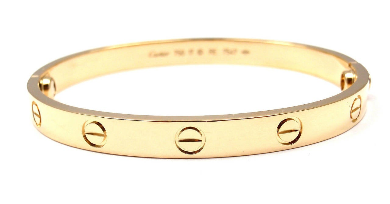 18k Yellow Gold LOVE Bangle Bracelet by Cartier. Size 17.   This beautiful Cartier Love Bangle comes with an original Cartier box  and a Screwdriver. This bracelet has a new screw system.  Details: Weight: 32.4 grams  Width: 6.5mm Stamped