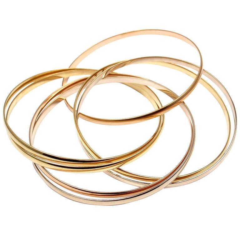c9a0ca7e327be Rare CARTIER Tri-Color Gold Trinity Rolling 7 Bangle Bracelet