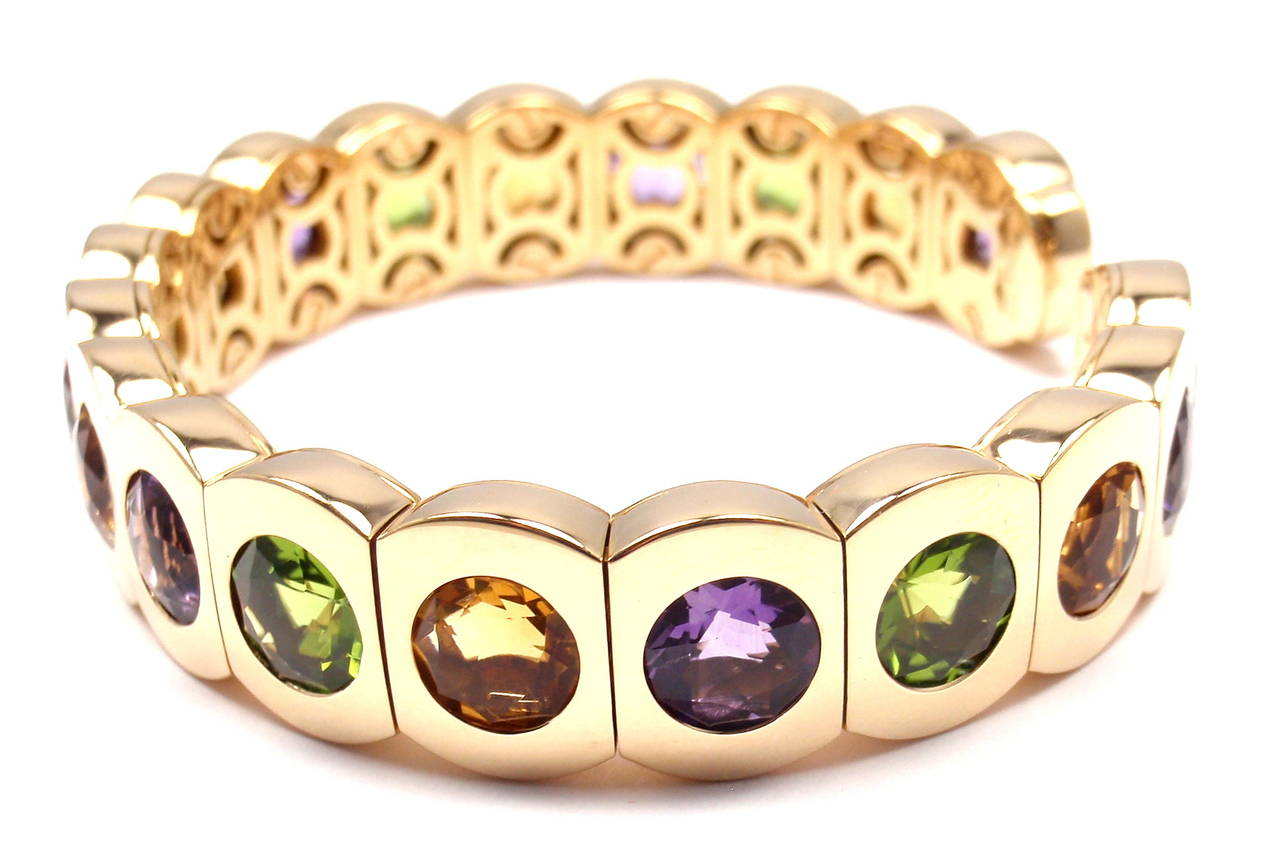 18k Yellow Gold Multi Color Stone Cuff Bangle Bracelet by Chanel.  With 7 round amethysts 9mm each 6 round citrines 9mm each 6 round peridot 9mm each  Details: Weight: 58.2 grams Length: 7