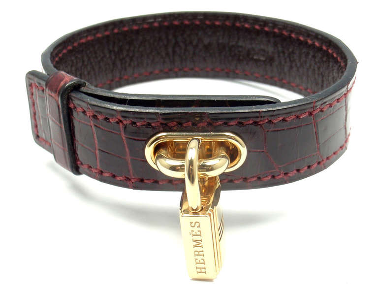 18k Yellow Gold Lock &  Crocodile Burgundy Bangle Bracelet by Hermes.  This bracelet comes with an original Hermes box.  Details:  Length: 7