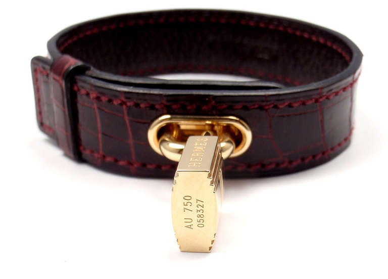 Hermes Crocodile Burgundy Yellow Gold Lock Bangle Bracelet In New Condition For Sale In Southampton, PA