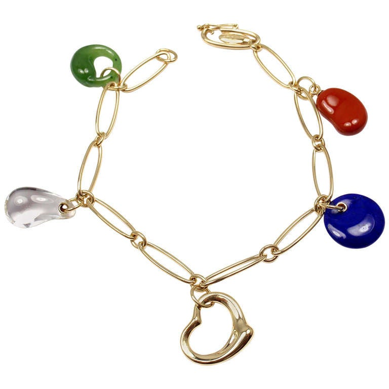 Tiffany Co Elsa Peretti Carved Gemstone Yellow Gold Charm Bracelet For