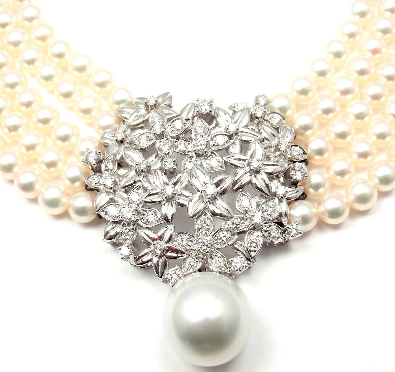 18k White Gold Diamond 5 Strand Pearl Necklace by Mikimoto.  With 700 total 5 mm A quality or better with very good luster. 1 x 13mm Large South Sea Pearl drop. 55 round brilliant cut diamonds VS1 clarity, G color total weight approx.