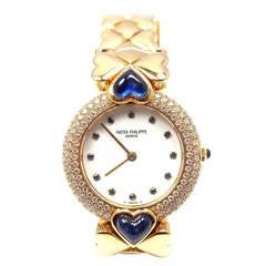 Patek Philippe Lady's Yellow Gold, Diamond and Sapphire Bracelet Watch