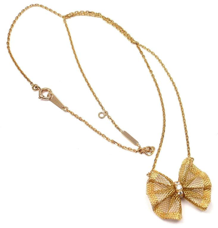 18k Yellow Gold Diamond Bow Pendant Necklace by Van Cleef & Arpels. With 4 diamond VS1 clarity, G color total weight .14ct   Details:  Necklace Length: 17'' Pendant: 25mm x 23mm Weight: 5.2 grams Stamped Hallmarks: VCA 18k 0.14ct