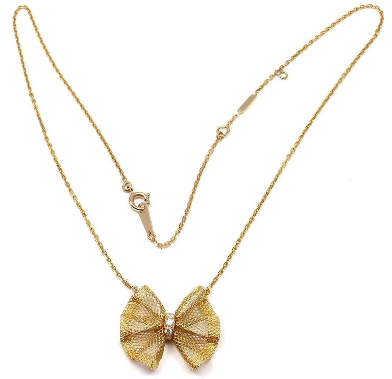 Van Cleef & Arpels Diamond Gold Bow Pendant Necklace In As new Condition For Sale In Southampton, PA