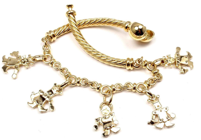 pomellato gold charm bangle bracelet at 1stdibs