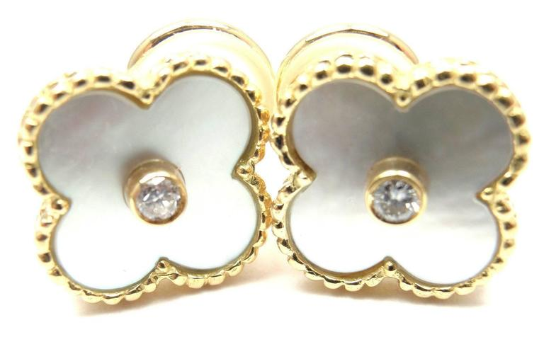 18k Yellow Gold Diamond And Mother of Pearl Earrings  by Van Cleef & Arpels.  With 2 Round brilliant cut diamonds .10ct F/VS1 Alhambra cut mother of pearl stones 15mm each. These earrings are for pierced ears. These earrings come with Van Cleef