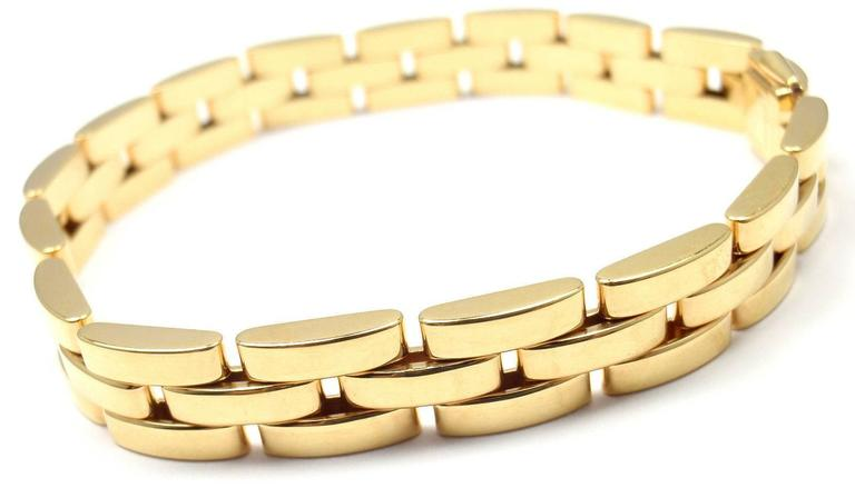 18k Yellow Gold Maillon Panthere 3-Row Link Bracelet by Cartier.  This lovely bracelet is in mint condition and it comes with original Cartier certificate and a Cartier box.  Measurements:  Length: 7 1/4