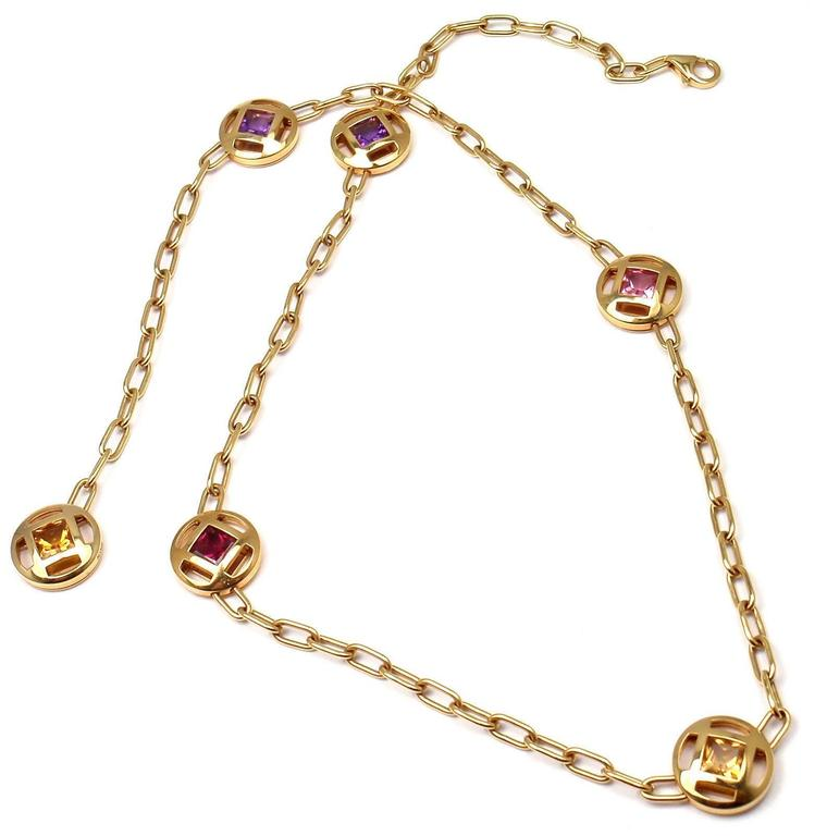 18k Yellow Gold Sapphire Amethyst Citrine Tourmaline Pasha Necklace by Cartier.  With 2 amethysts, 1 citrine, 1 yellow sapphire, 2 pink tourmalines This necklace is in mint condition and comes with Cartier box and Cartier certificate.  Details: