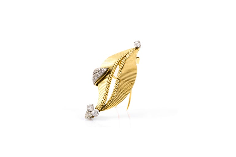 Signed Cartier 18k yellow gold brooch with 2.00 carats of round brilliant cut diamonds.