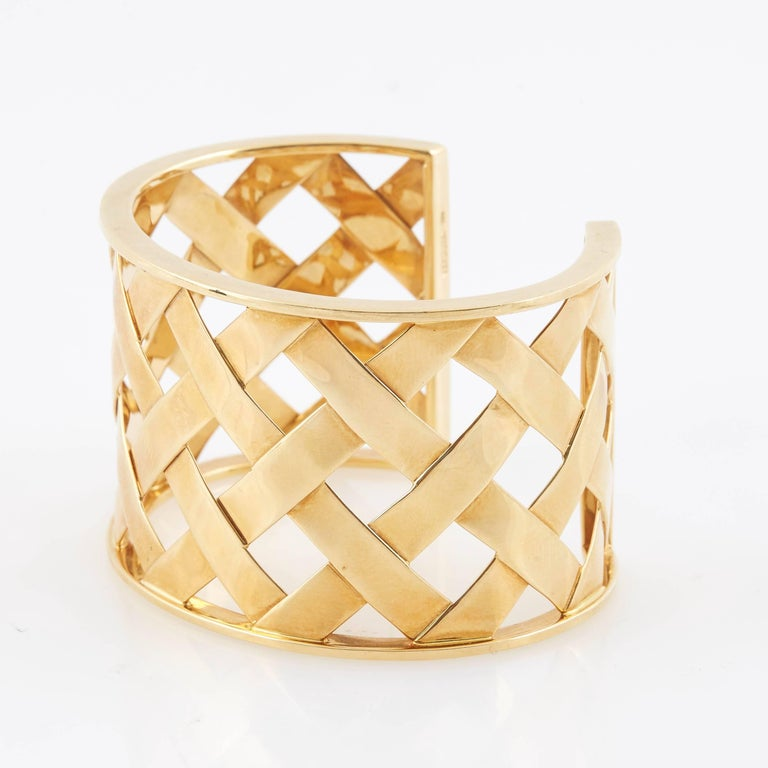 Beautiful Criss Cross cuff bracelet, in high-polished 18k rose gold. Slip-on style. Designed by Verdura.