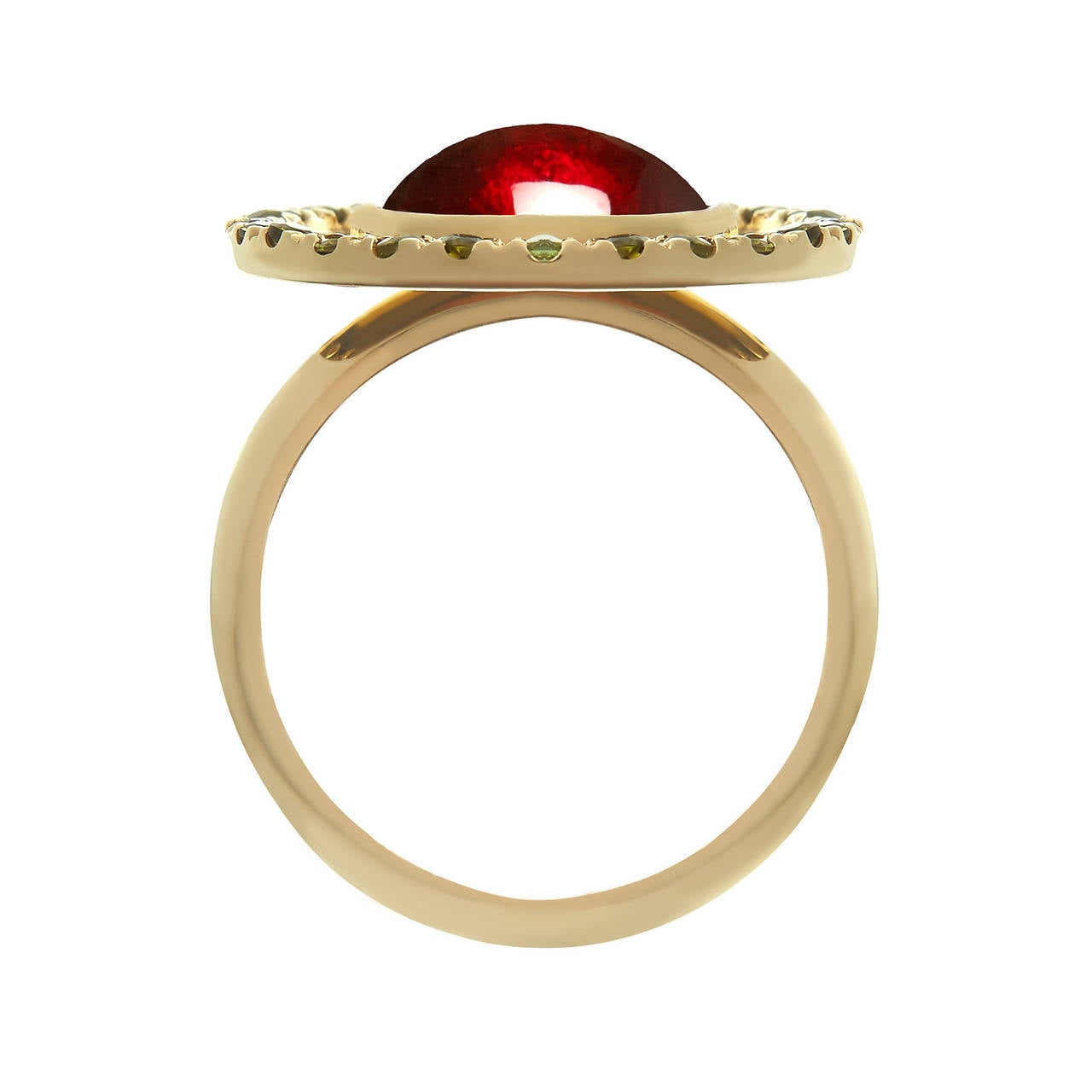 18ct yellow gold, garnet and green tourmaline ring  In Tessa's world wearing sweets is more fun than eating sweets. The designer cites the retro, sherbet-filled Flying Saucer sweet as the inspiration for this pretty cocktail ring. Hand crafted in
