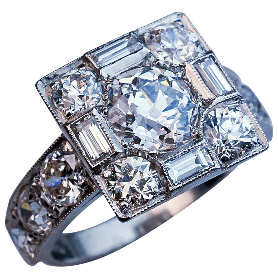 Art Deco Diamond Platinum Cluster Engagement Ring For Sale