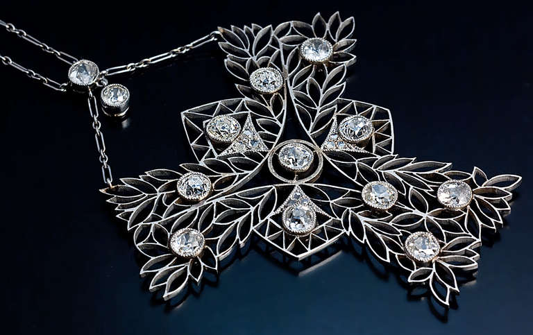 A French rhodium plated 18K gold necklace designed as an openwork stylized tree in Art Nouveau taste, embellished with old cushion cut and rose cut diamonds. Estimated total diamond weight 3.50 carats. Average color H, average clarity SI1.