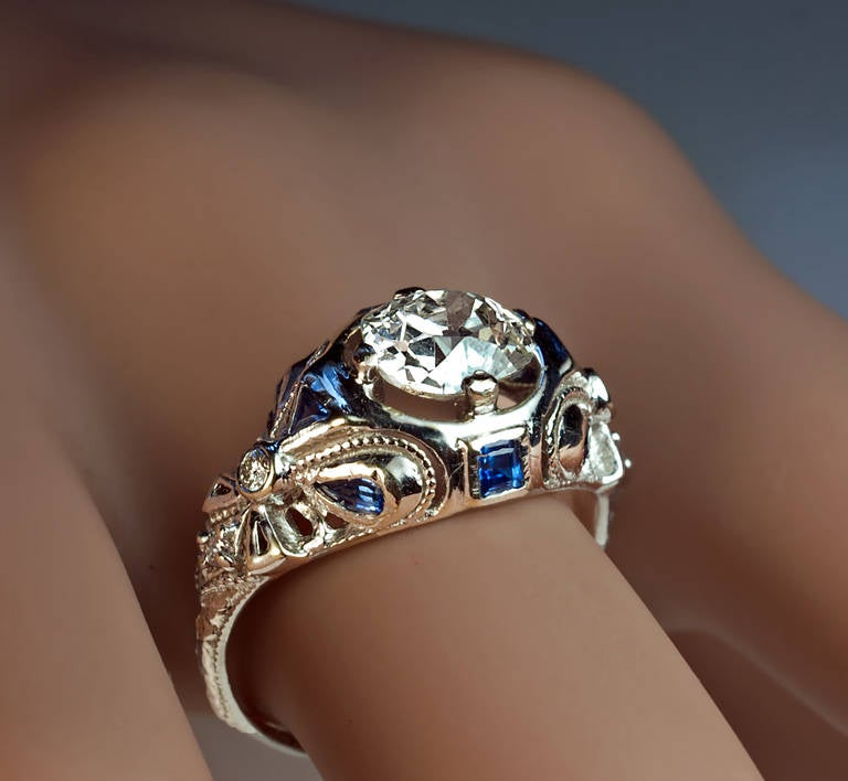 a 14K white gold ring centered with an old cushion cut diamond