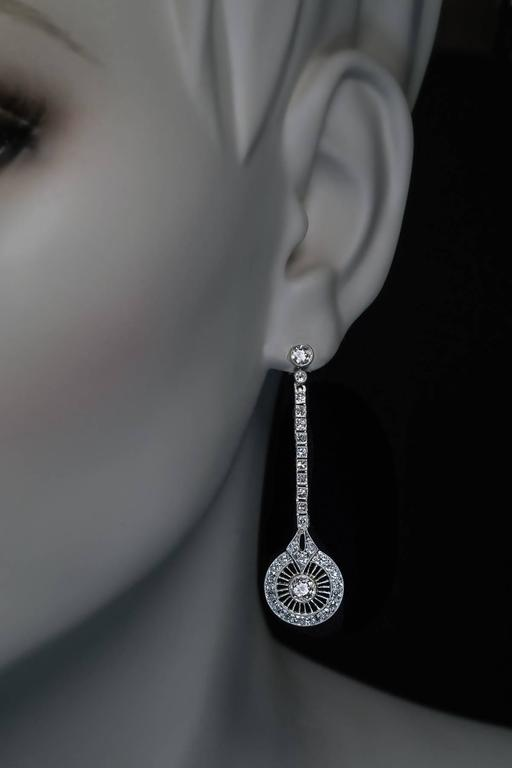 A pair of stylish 1920s Art Deco vintage long earrings handcrafted in  platinum topped 18K gold 0863940303