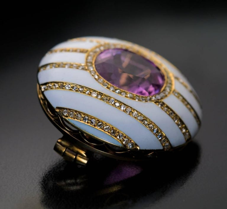Made in St. Petersburg in the 1890s  The rare antique FABERGE button-shaped brooch is centered with a sparkling pink tourmaline that is elegantly complimented by a glossy white enamel background inlaid with channels of rose cut diamonds.  Diameter