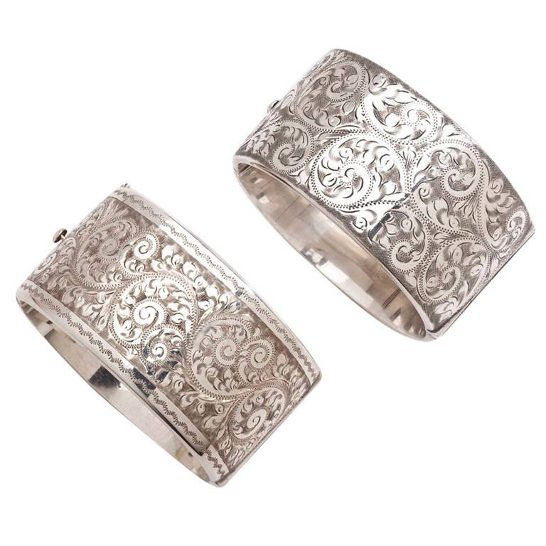 A Pair Of Victorian Floral Engraved Silver Cuffs For Sale