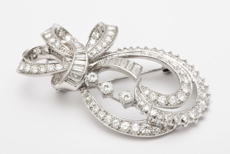 Radiant Bow and Ribbon Diamond Pendant or Brooch, circa 1950 In Excellent Condition For Sale In Stamford, CT