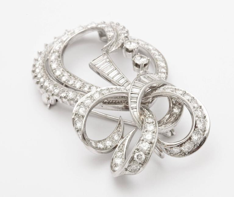 Women's Radiant Bow and Ribbon Diamond Pendant or Brooch, circa 1950 For Sale