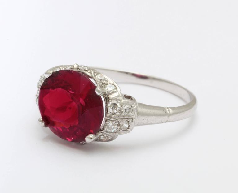 So beautiful you can taste it as an engagement ring or fashion addition, this 3.6 ct rhodolite garnet and diamond ring, from the mid 20th century holds single cut diamonds of .41cts of bright G-H color and VS clarity that surround the red fiery
