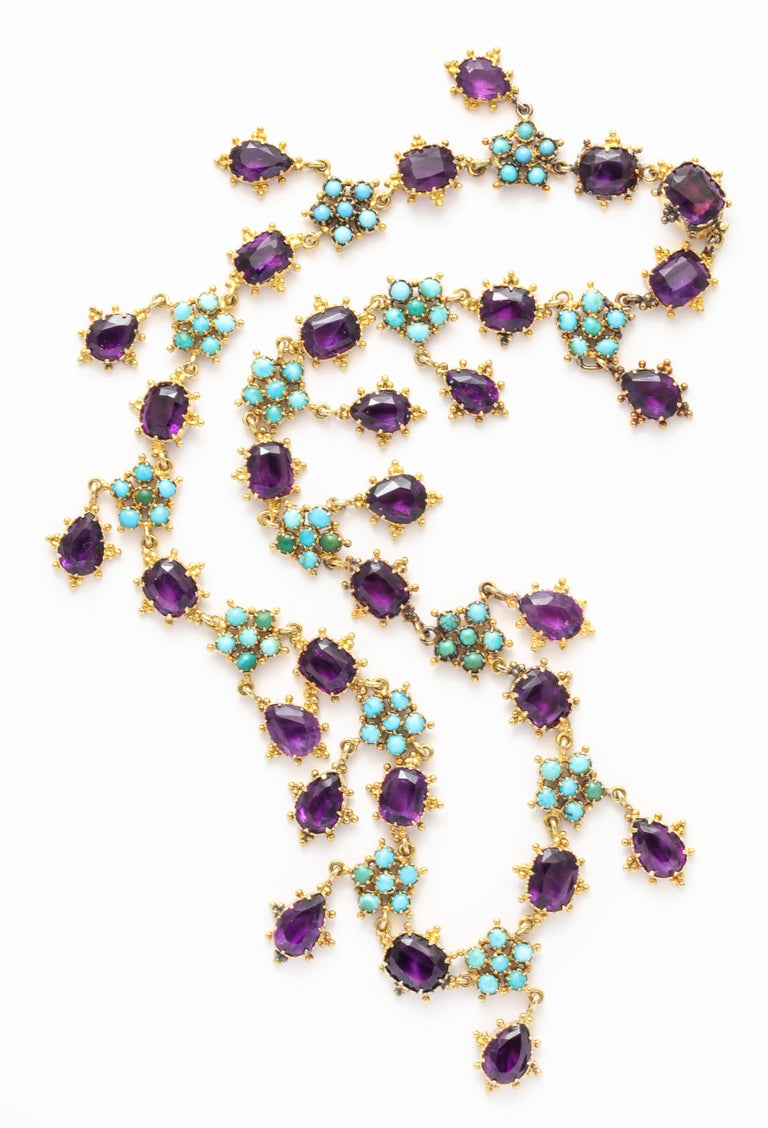Lush granulation surrounds every amethyst and turquoise flower as the links join pear shaped and rounded corner amethysts with natural turquoise. This rare beauty was made c. 1855 when Queen Victoria was young and  the aristocracy were the only