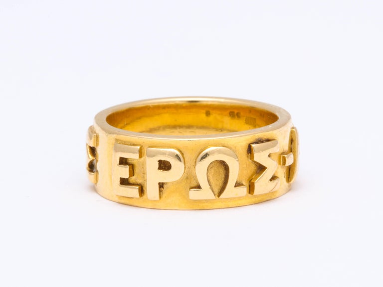 One of a kind, and likely a special commission, the extraordinary 18 kt gold wedding band is clearly engraved with raised Greek letters spelling the fervent message of immortal love.  The ring is solid gold, strong and unscathed. It is remarkable