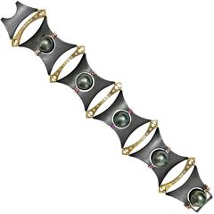 Rolling Tahitian Pearl Color Change Garnet Diamond Award Winning AXIS Bracelet