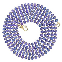 222.00 Carat Shimmering Tanzanite Faceted Gold Elements Long Necklace