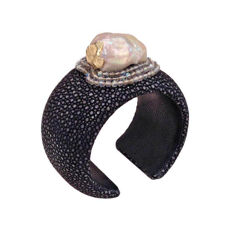 One-of-a-Kind Black Shagreen Cuff with sharkskin, moonstone beads, and a (29mm x 28mm) lustrous white baroque pearl with an 18k yellow gold leaf accent. Adjustable.