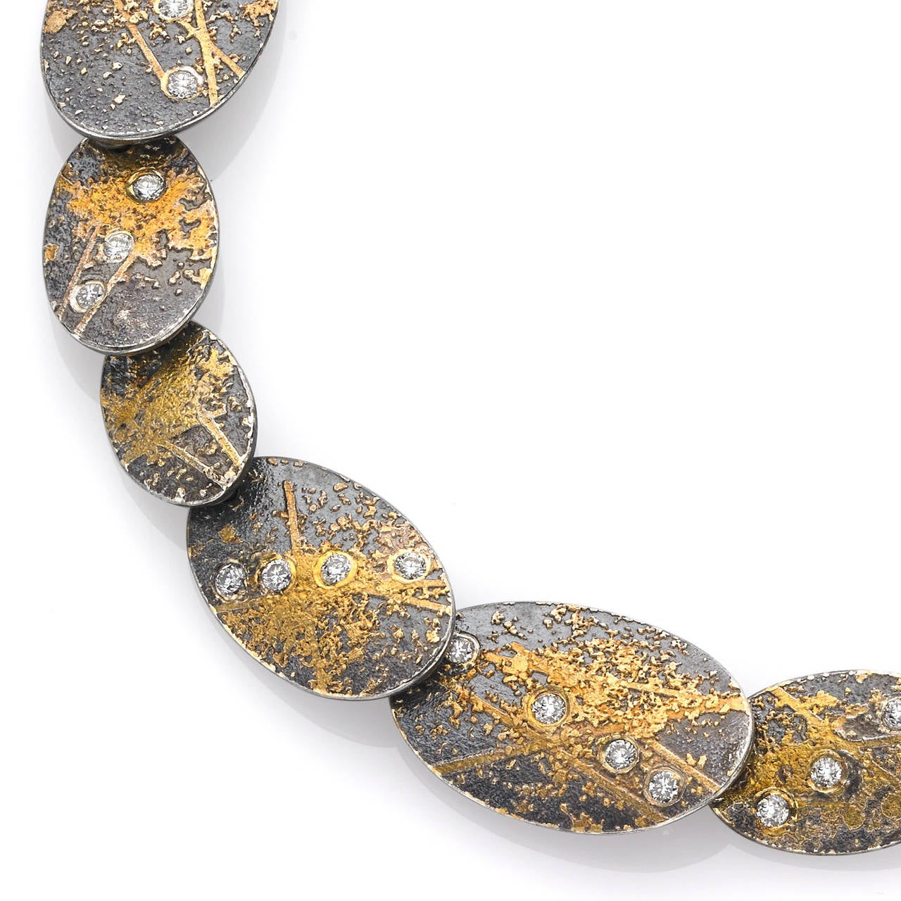 One-of-a-Kind Oval Links Bracelet handcrafted in Germany by renowned jewelry maker Atelier Zobel (Peter Schmid) in 18k yellow gold, 24k gold, and oxidized sterling silver with 0.25 carats of round brilliant-cut white diamonds. Stamped and Hallmarked.