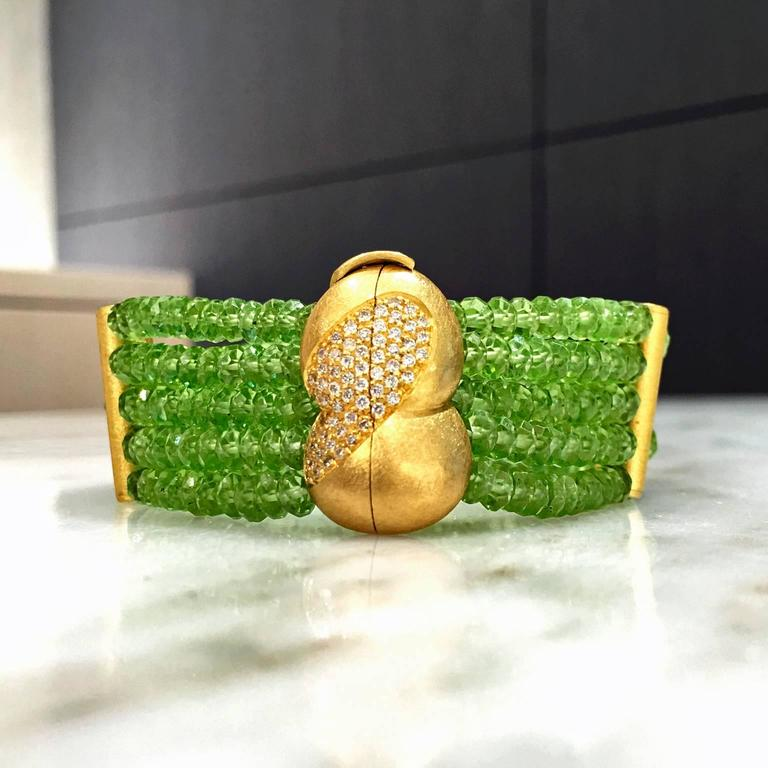 One-of-a-Kind Faceted Peridot Five Strand Bracelet handcrafted by German jewelry artist Eva Steinberg in matte-finished 21k yellow gold with 62 internally flawless, round brilliant-cut white diamonds totaling 0.50 carats, bezel-set in a 21k yellow