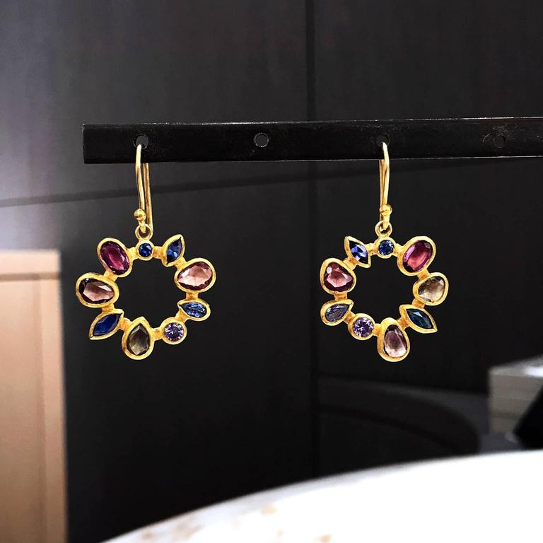One of a Kind Radial Drop Earrings handcrafted by renowned jewelry designer Petra Class with beautifully harmonized shimmering blue, violet, red and purple faceted Montana sapphires bezel-set in Petra's signature 22k yellow gold dangling on 18k
