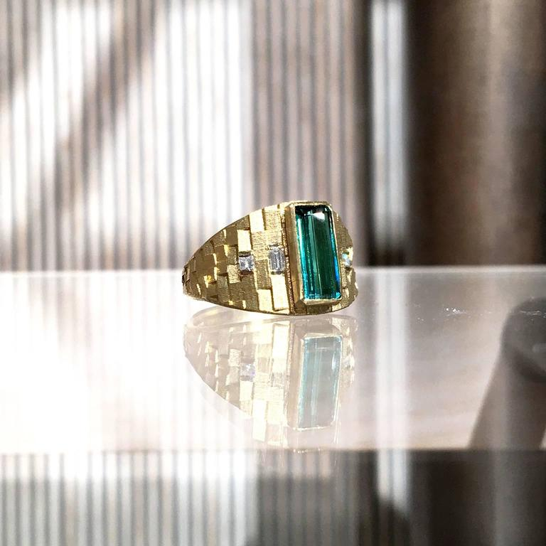 One of a Kind Tapered Deco Ring created by London-based jewellery artist Jo Hayes Ward showcasing a 1.30 carat bluish green tourmaline custom-cut baguette (10mm x 4mm), two white diamond baguettes, and two princess-cut white diamonds, all bezel-set