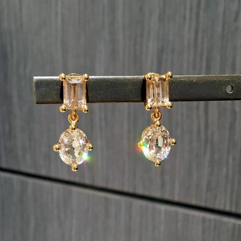 One of a Kind Princess Earrings handcrafted in Idar Oberstein, Germany by renowned master jewelry artist Erich Zimmermann in 18k yellow-toned rose gold showcasing two sets of spectacular, fiery, brilliant-cut natural Tanzanian zircons, one set
