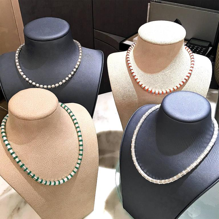 Four Cleopatra Necklaces handcrafted in Idar-Oberstein Germany by acclaimed master metalsmith and jewelry designer Erich Zimmermann. Each Necklace features dozens of individual handmade and matte-finished sterling silver cylindrical elements
