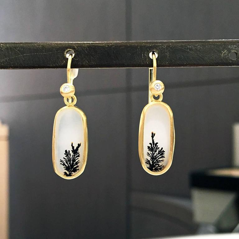 One of a Kind Dangle Earrings handcrafted in matte-finished 18k yellow gold showcasing a matched pair of translucent white and black dendrite agate, and accented by two round brilliant-cut white diamondss attached to 18k yellow gold ear wires.