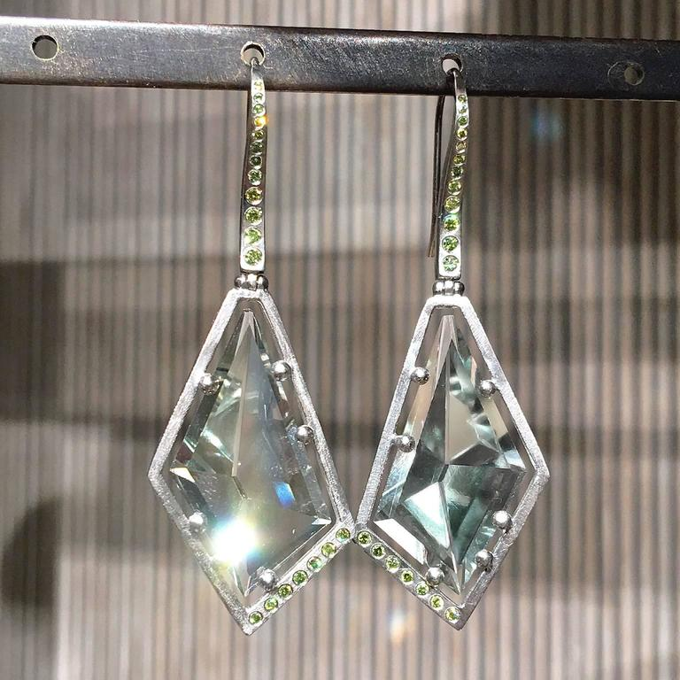 One of a Kind Drop Earrings showcasing two custom-cut and faceted sage green amethysts handcrafted in etched-finish 950 palladium with ice green (enhanced color) diamond accents totaling 0.2622 carats.
