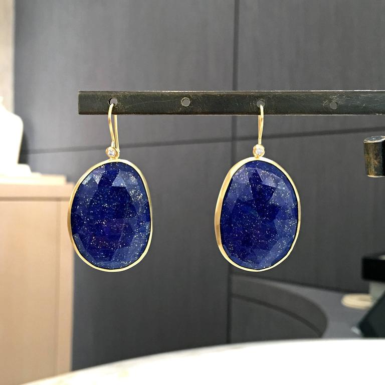 One of a Kind Earrings handcrafted by jewelry artist Monica Marcella in matte-finished 18k yellow gold with an absolutely spectacular matched pair of faceted, violet blue lapis lazuli with shimmering gold pyrite flecks. The lapis is accented by two
